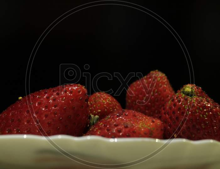 Red Fresh Organic Juicy Strawberries On A White Plate.
