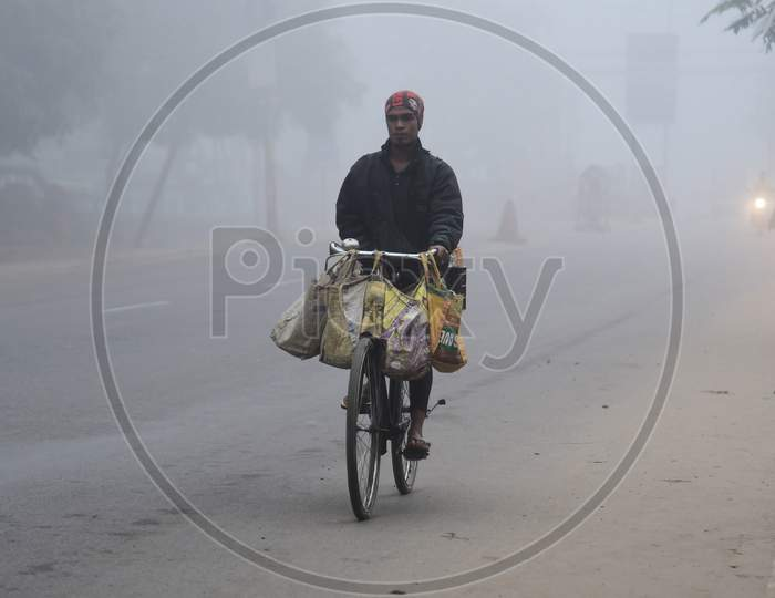 A man ride his bicycle  on a foggy and cold morning in Assam on Dec 28,2020.
