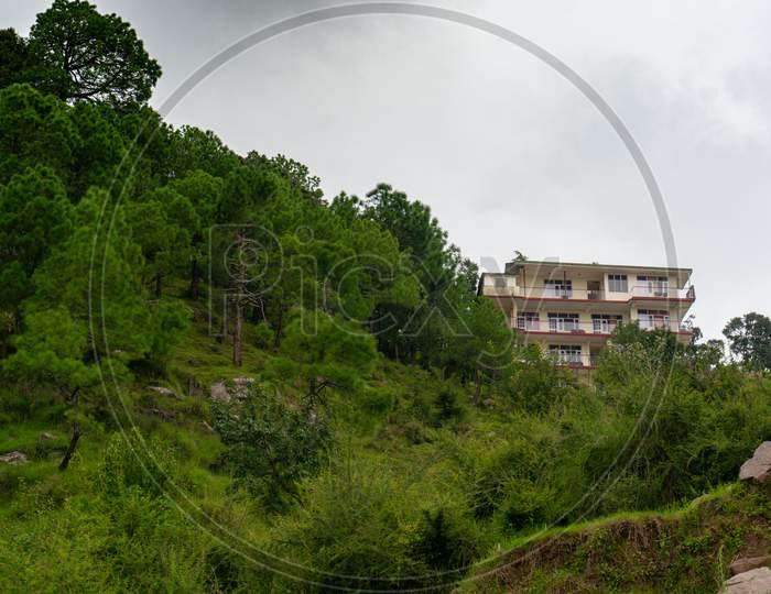 Large Concrete Buildings Of Hotels Homestays And Residences In Hill Stations In India Like Shimla, Dharamshala, Nainital And More Which Are Popular Tourist Vacation And Work Remotely Destinations