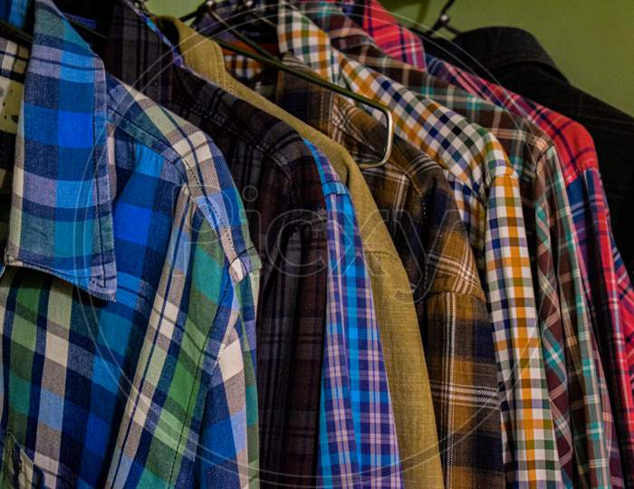 Collection Of Different Types And Colors Of Men Shirts In Wardrobe.