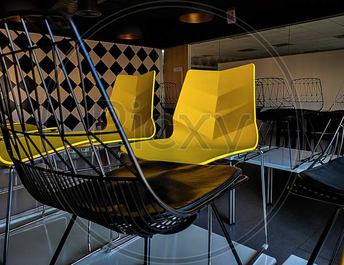 Picture Of Yellow And Black Colors Chairs Use In Meetings In It Company Bangalore India.
