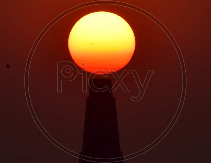 The sun set behind the brick kiln factory  in Assam on Dec 31,2020