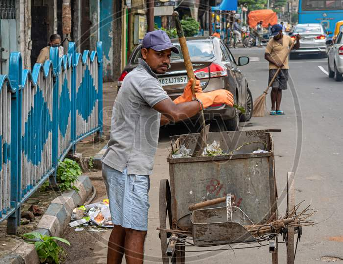 A Sweeper Sweeps The Street Of Kolkata, India On October 2020