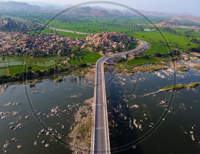 Aerial View Of Bridge Connecting North And South Hampi Over Tungabadra River