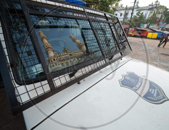 Reflection Of Charminar On Hyderabad Police Vehicle Glass