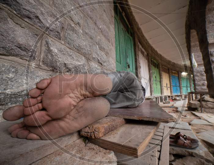 A Man Sleeping At The Corridor In MJ Market
