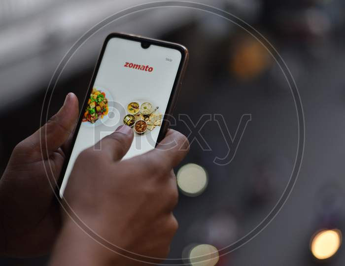 Indian Man ordering food on Zomato App