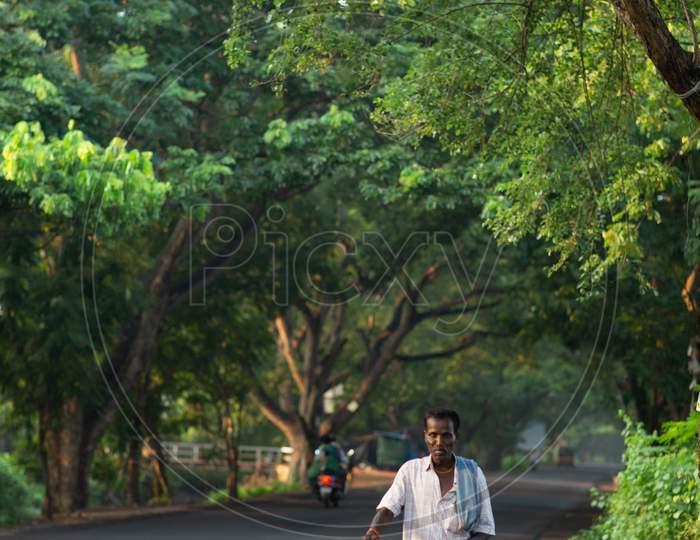 Indian Man walking wearing lungi