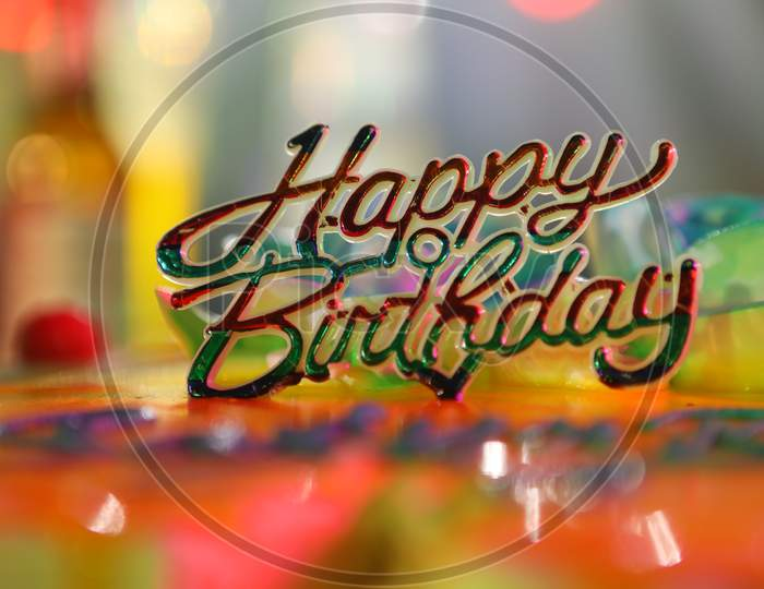 Happy Birthday Tag On an Birthday Cake With Neon Lights Background