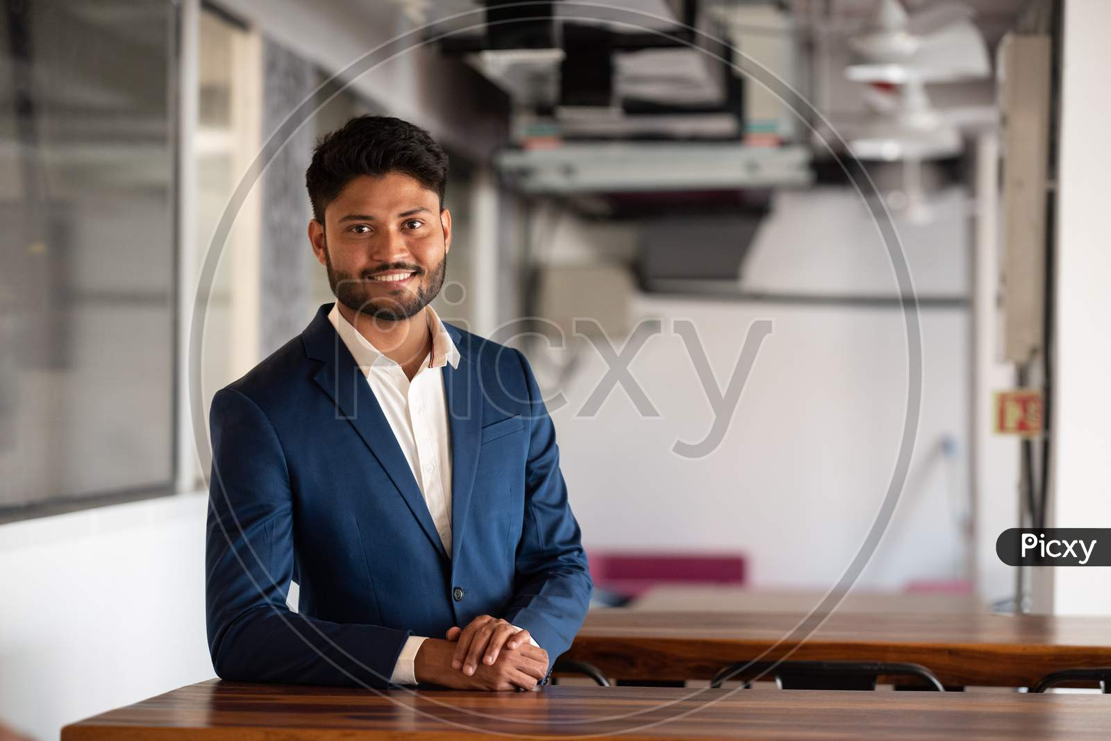 Successful Indian Businessman At Office Wearing Suite