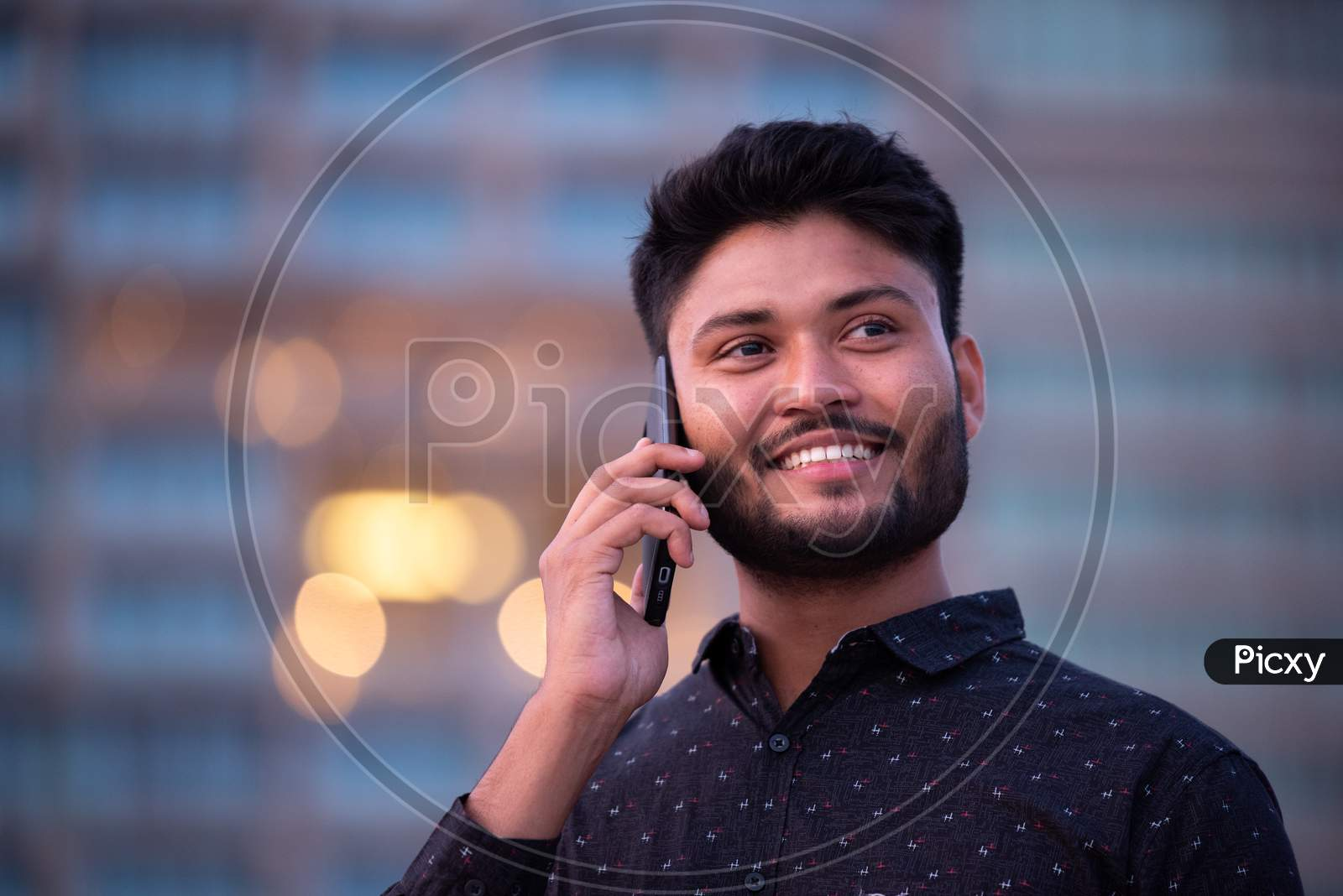 Young Indian Businessman With Smile Face  Speaking in Mobile