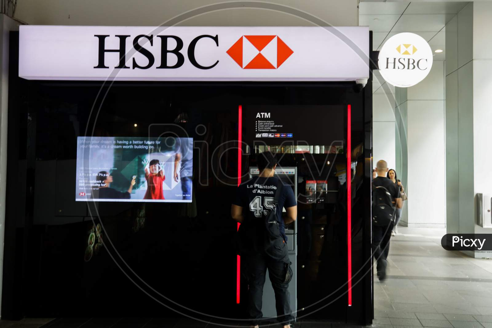 HSBC Bank ATM With A Man  Using The ATM Machine