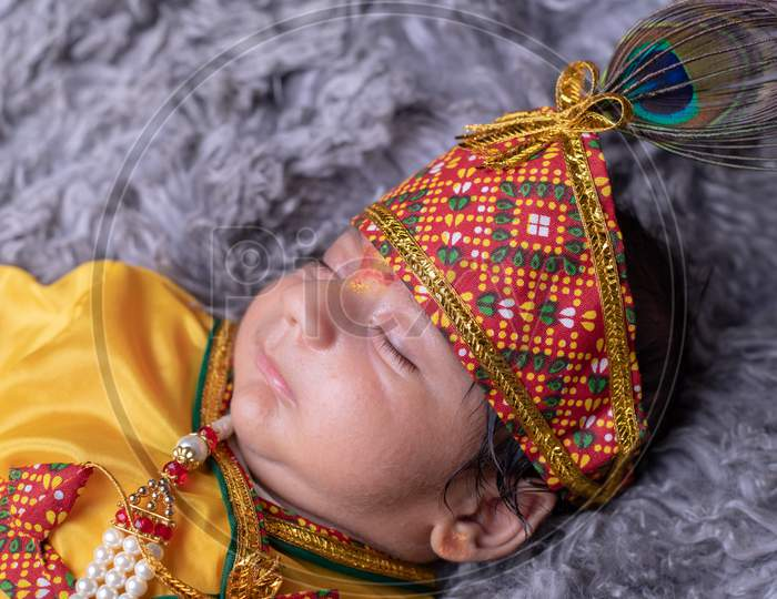 Cute Little Baby In Lord Sri Krishna Clothes  Sleeping Calmly