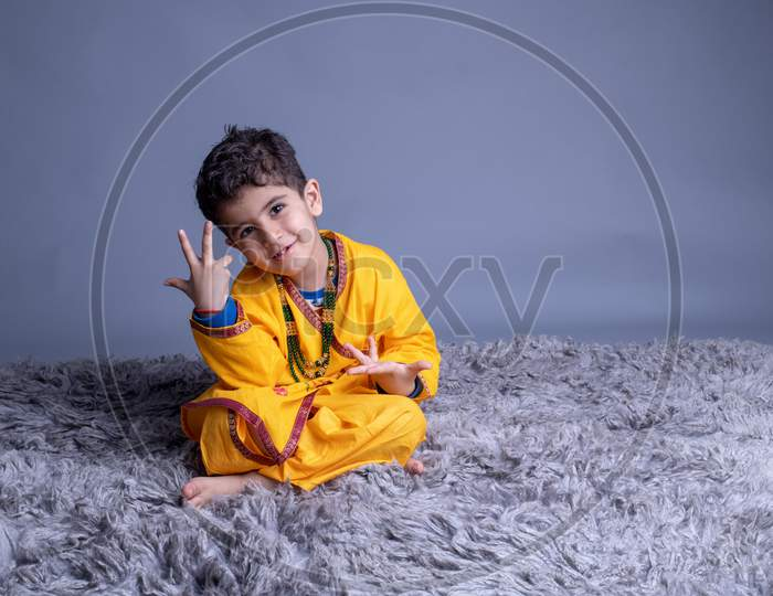 Adorable Indian Boy Dressed as Lord Sri krishna And Posing