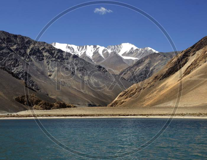 A View Of Snow Capped Mountains And Pangong Lake  In Leh