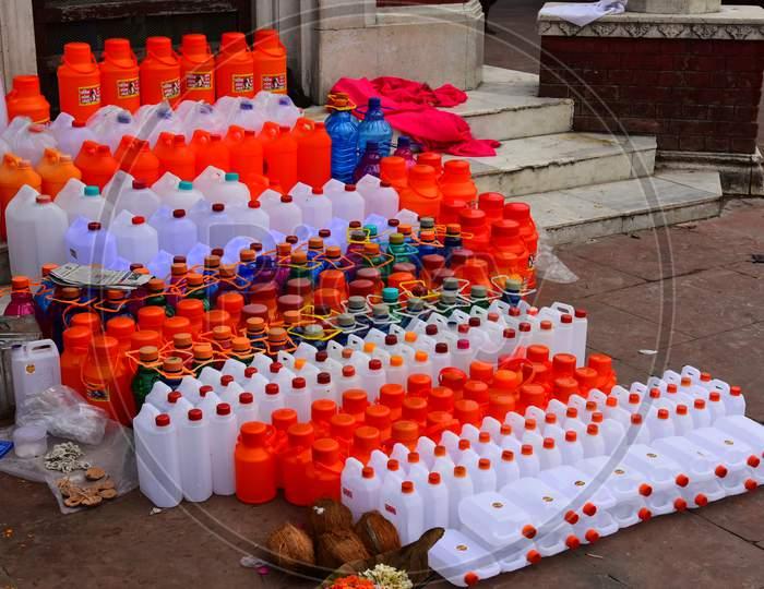Vendors Selling Holy River Ganga Water In Plastic Bottles At Bramha Kund , Haridwar