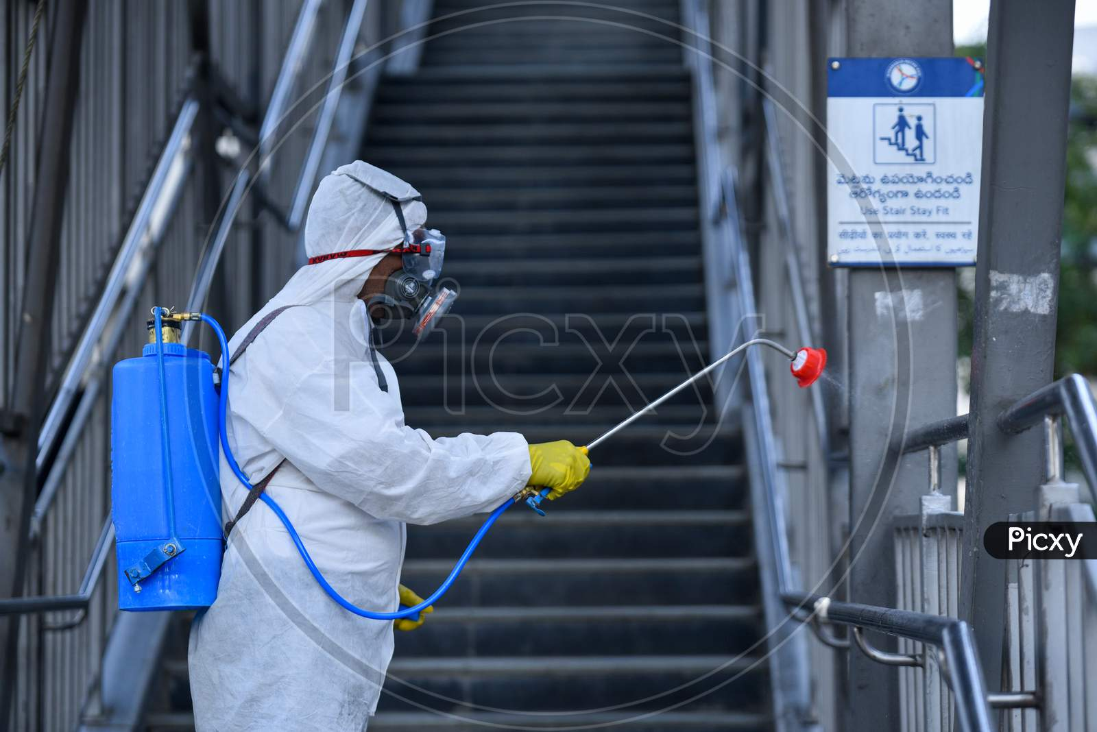 Disaster Response Force(Drf) Team Spraying Disinfectant Solution Across The Hyderabad City To Reduce The Spread Of The Covid-19 Virus Or Coronavirus With Full Body Masks On
