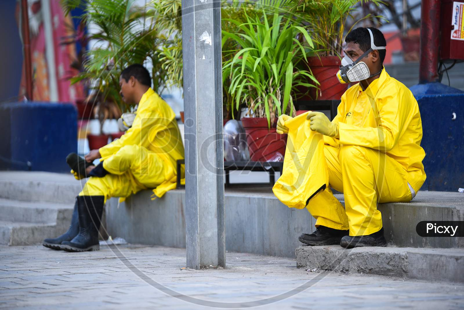 Disaster Response Force(Drf) Team With Full Body Suits Taking Rest After Spraying Disinfectant Solution Across The Hyderabad City To Reduce The Spread Of The Covid-19 Virus Or Coronavirus