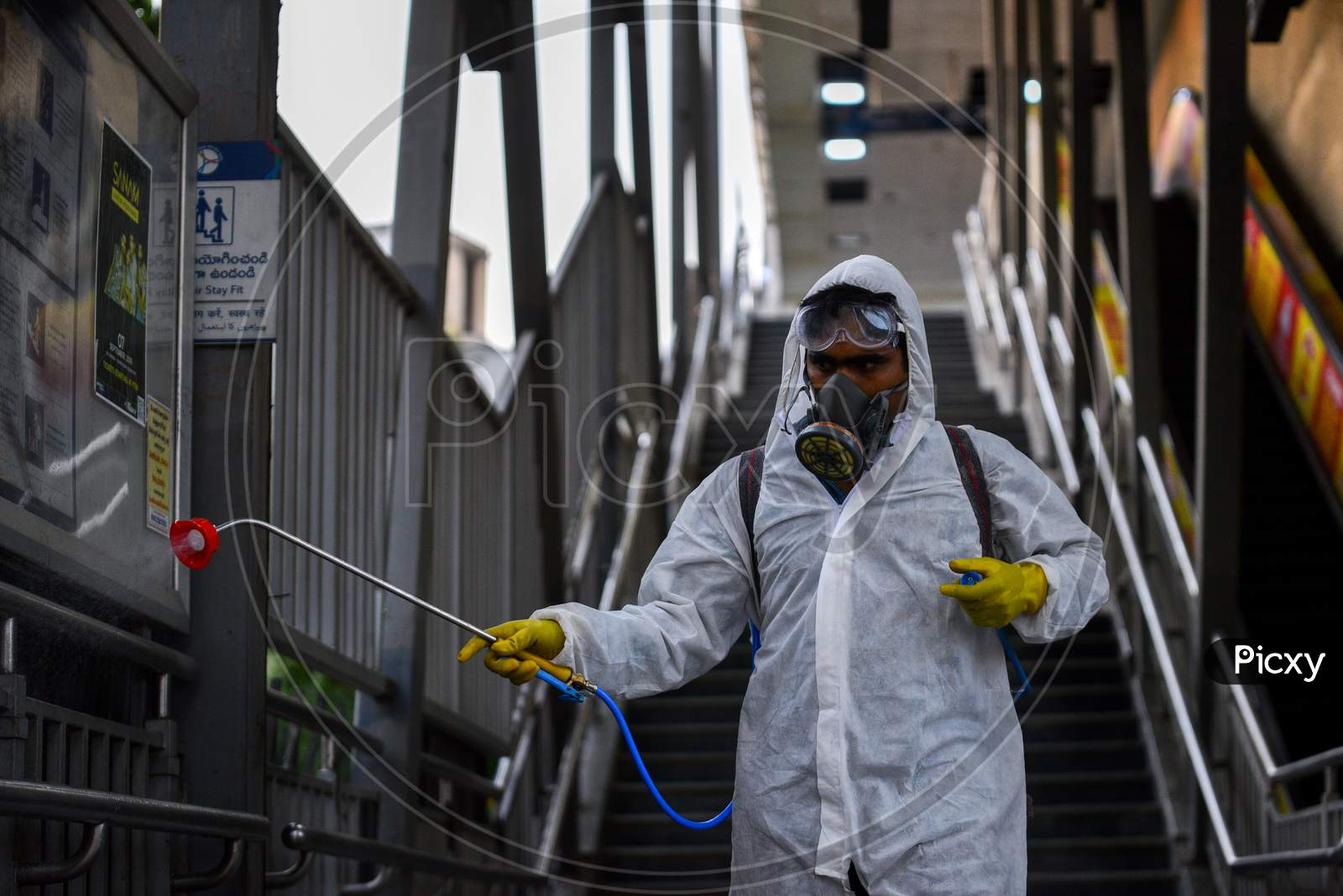 Disaster Response Force(Drf) Team With Full Body Suits Spraying Disinfectant Solution Across The Hyderabad City To Reduce The Spread Of The Covid-19 Virus Or Coronavirus At Ameerpet Metro Station