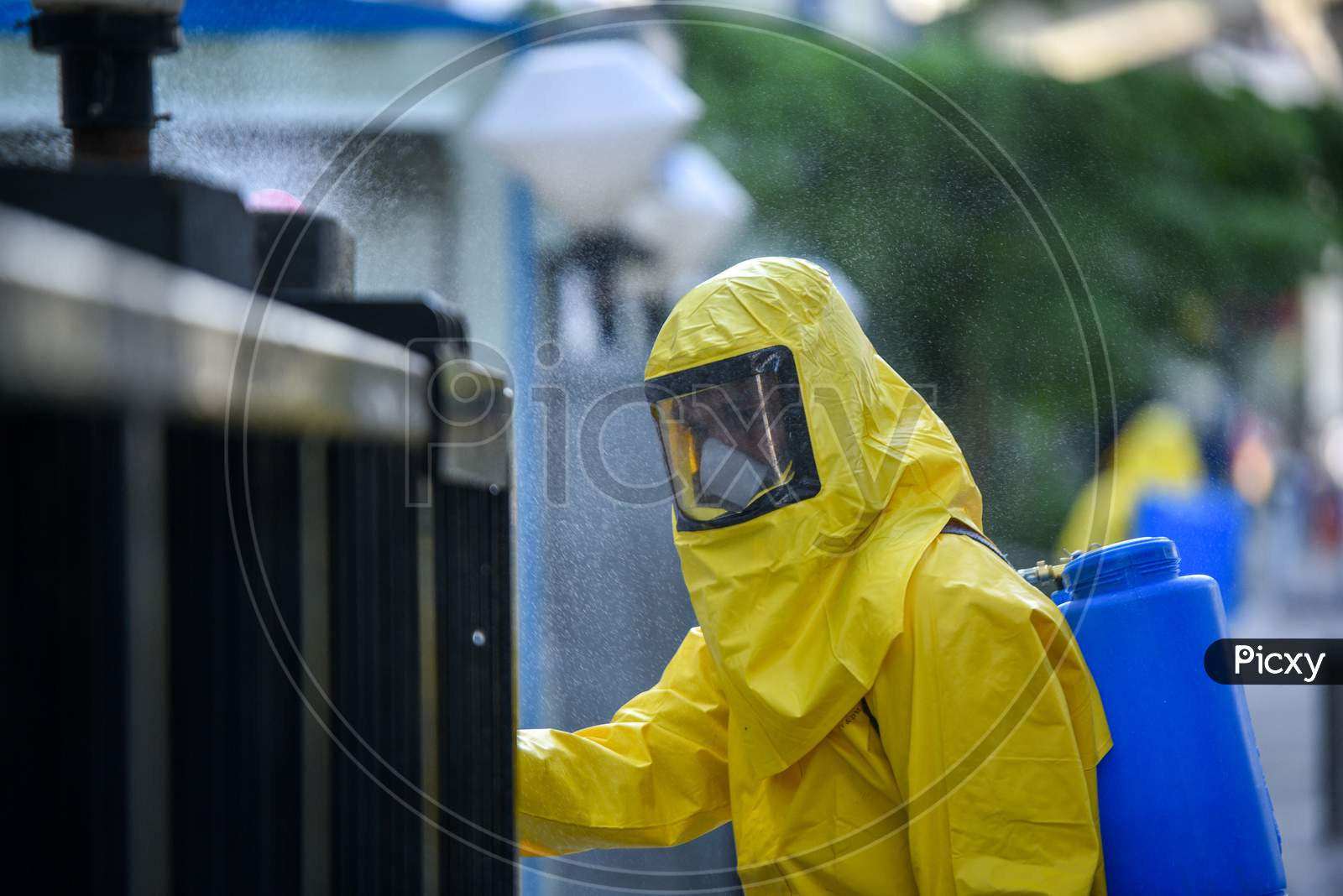 Disaster Response Force(Drf) Team With Full Body Suits Spraying Disinfectant Solution Across The Hyderabad City To Reduce The Spread Of The Covid-19 Virus Or Coronavirus