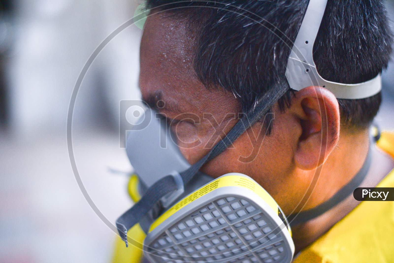 Disaster Response Force(Drf) Man Sweating Heavily After Spraying Disinfectant Solution Across The Hyderabad City To Reduce The Spread Of The Covid-19 Virus Or Coronavirus At Ameerpet Metro Station