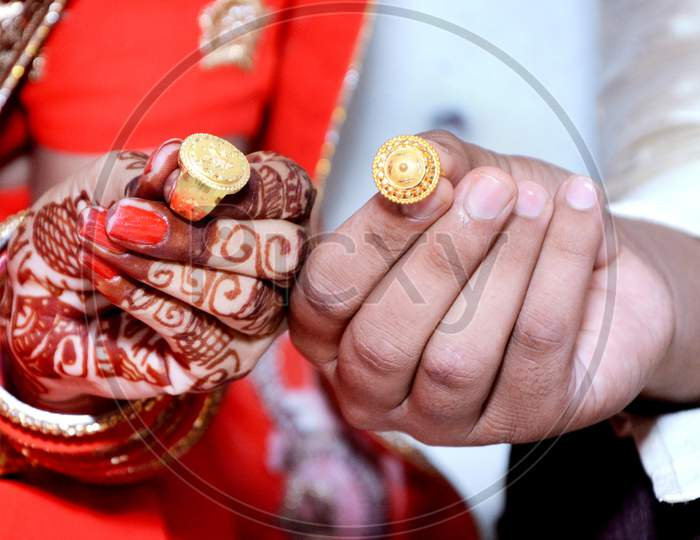 An Indian Bride And Groom Their Shows Engagement Rings During A Hindu Wedding Ritual