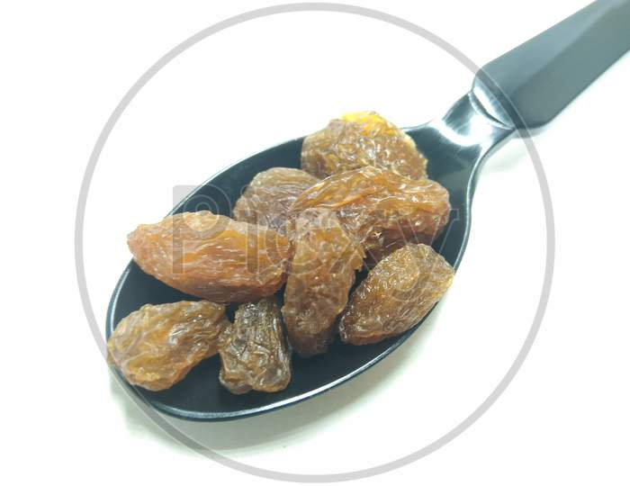 Dried Grapes Or Raisin On an White Background