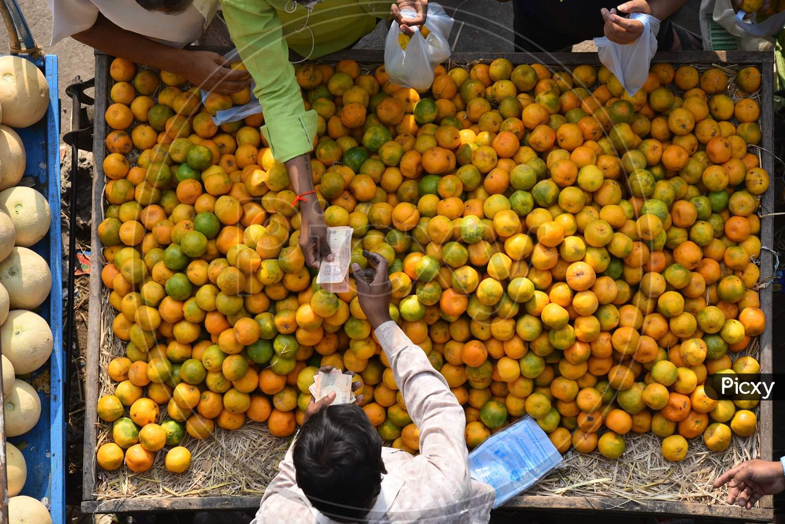 People buy citric acid rich fruits like orange, mausambi fruits to increase their immunity amid corona virus pandemic in Hyderabad