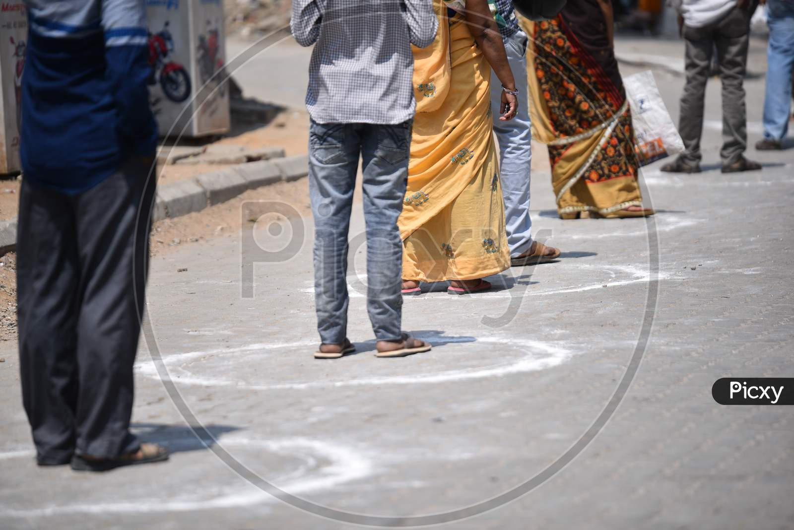 People Maintain Social Distancing By Standing In The Circles Drawn At A Super Market In Moosapet Y Junction, Hyderabad Amid Lockdown Due To Corona Virus Pandemic