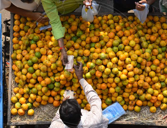 People buy citric acid rich fruits like orange, mausambi fruits to increase their immunity amid corona virus pandemic in Hyderabad