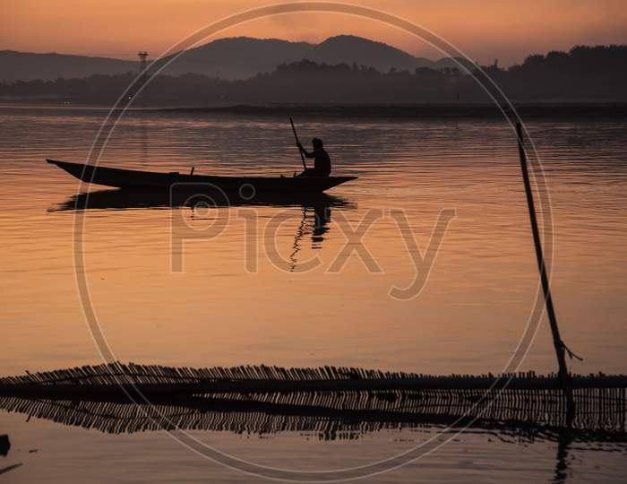 Fishermen Fishing In The Brahmaputra River At Sunset, In Guwahati On 29 Feb. 2020