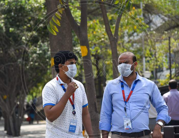 Employees of Raheja Mindspace IT Park wearing preventive face masks to protect themselves from CoVID19, Corona Virus