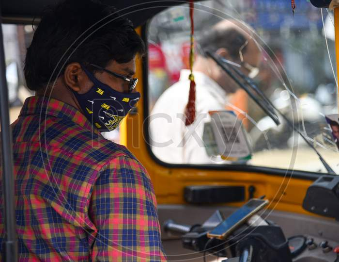 An Auto driver wearing preventive face mask to protect himself from CoVID19, Corona Virus