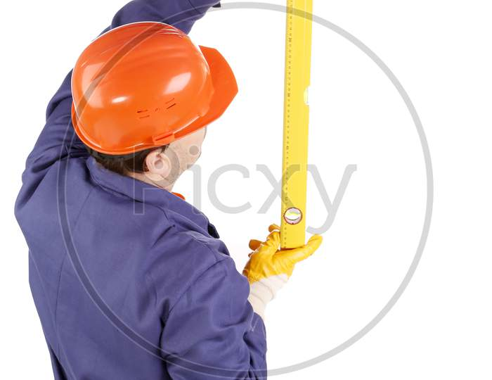 Worker In Hard Hat Raising Ruler. Isolated On A White Background.