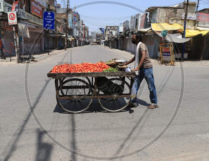 A Vendor Selling Vegitables On The Empty Raod During A Nationwide Lockdown To Slow The Spreading Of The Coronavirus Disease (Covid-19), In Prayagraj, April, 17, 2020.