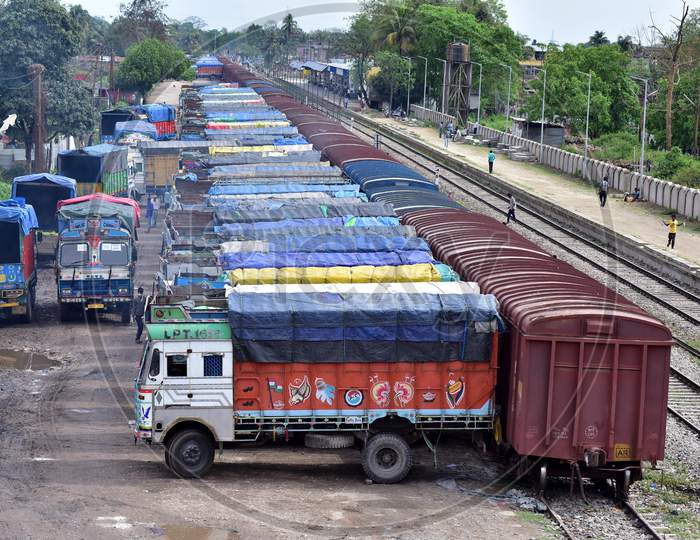 Trucks Lined Up To Upload Essential Commodities That Are Supplied From Other States In Goods Train Amid The Nation Wide Lockdown In The Wake Of Covid19 Outbreak At Haibargaon Railway Station In Nagaon District Of Assam On April 17,2020.