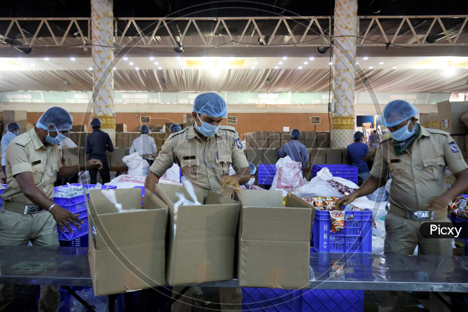 Bangalore City Police Taking The Groceries Packets For Distribution For Poor People In Bangalore City During Corona Virus Or Covid-19 Pandemic