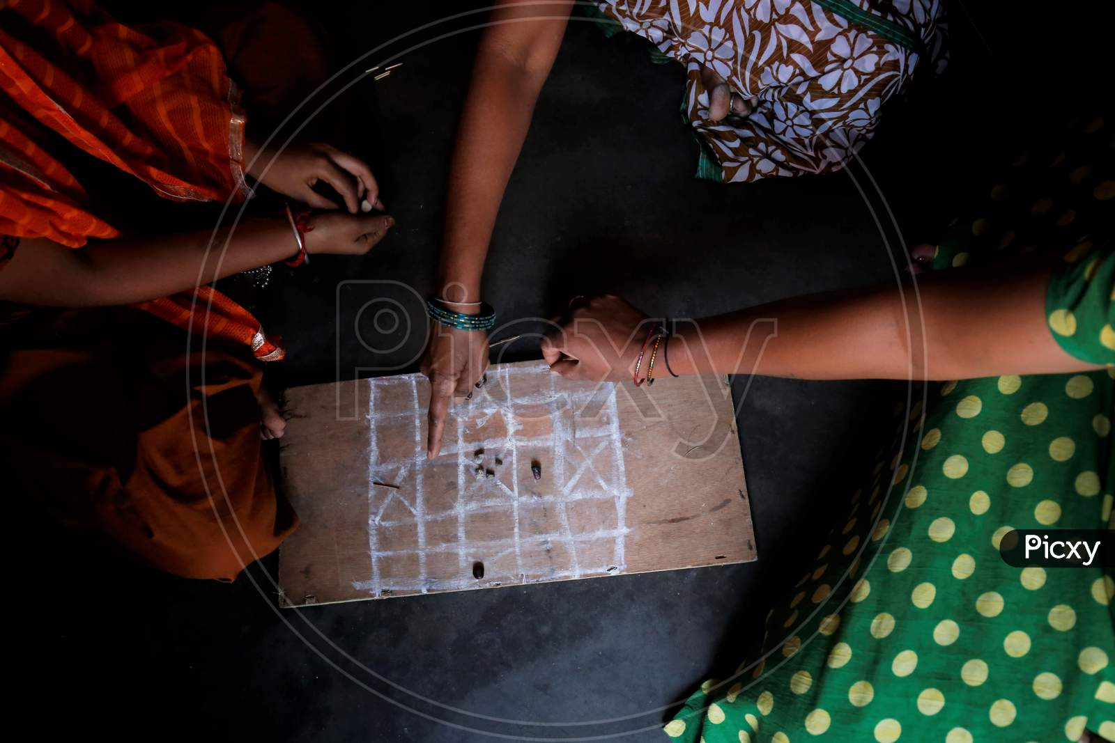 Indian House Wives Playing Traditional Indian Board Games In Houses During Corona Virus ( Covid-19)  Lockdown