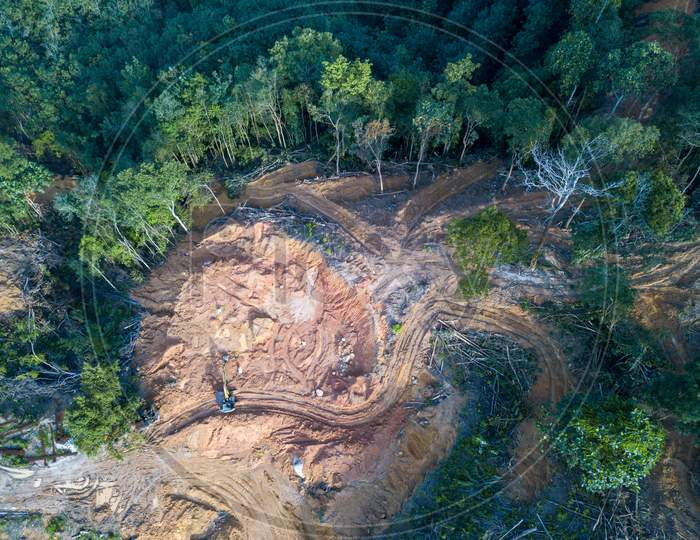 Aerial View Look Down Excavator And Land Clearing At Forest.