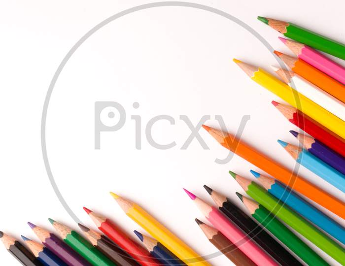 colourful pencils isolated templates to be used as background.
