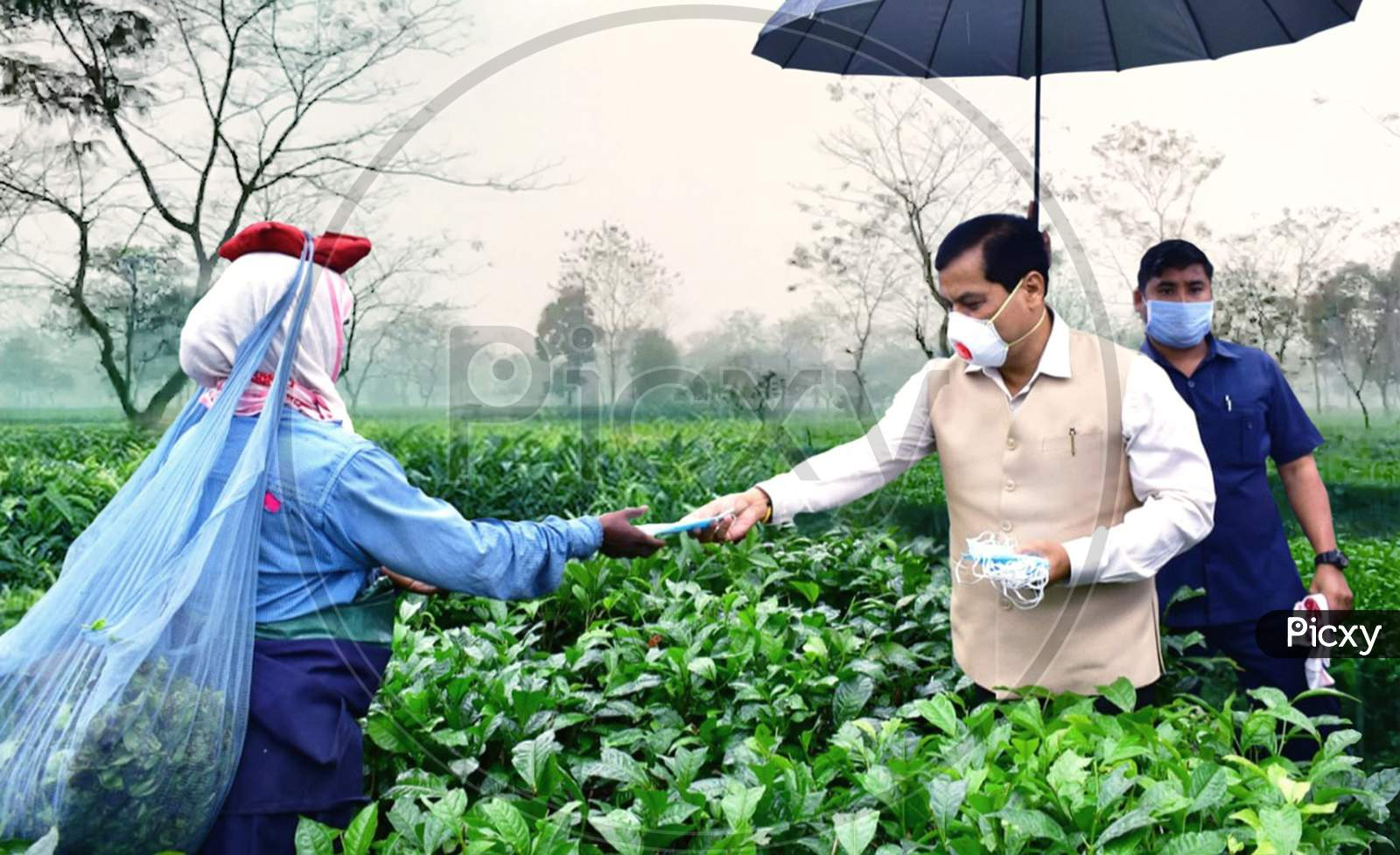 Assam Chief Minister Sarbananda Sonowal Distributing Face Mask Among The Tea Tribe Workers  During Nationwide Lockdown Amidst Coronavirus or COVID-19  Outbreak  in Dibrugarh District Of Assam On April 24,2020.