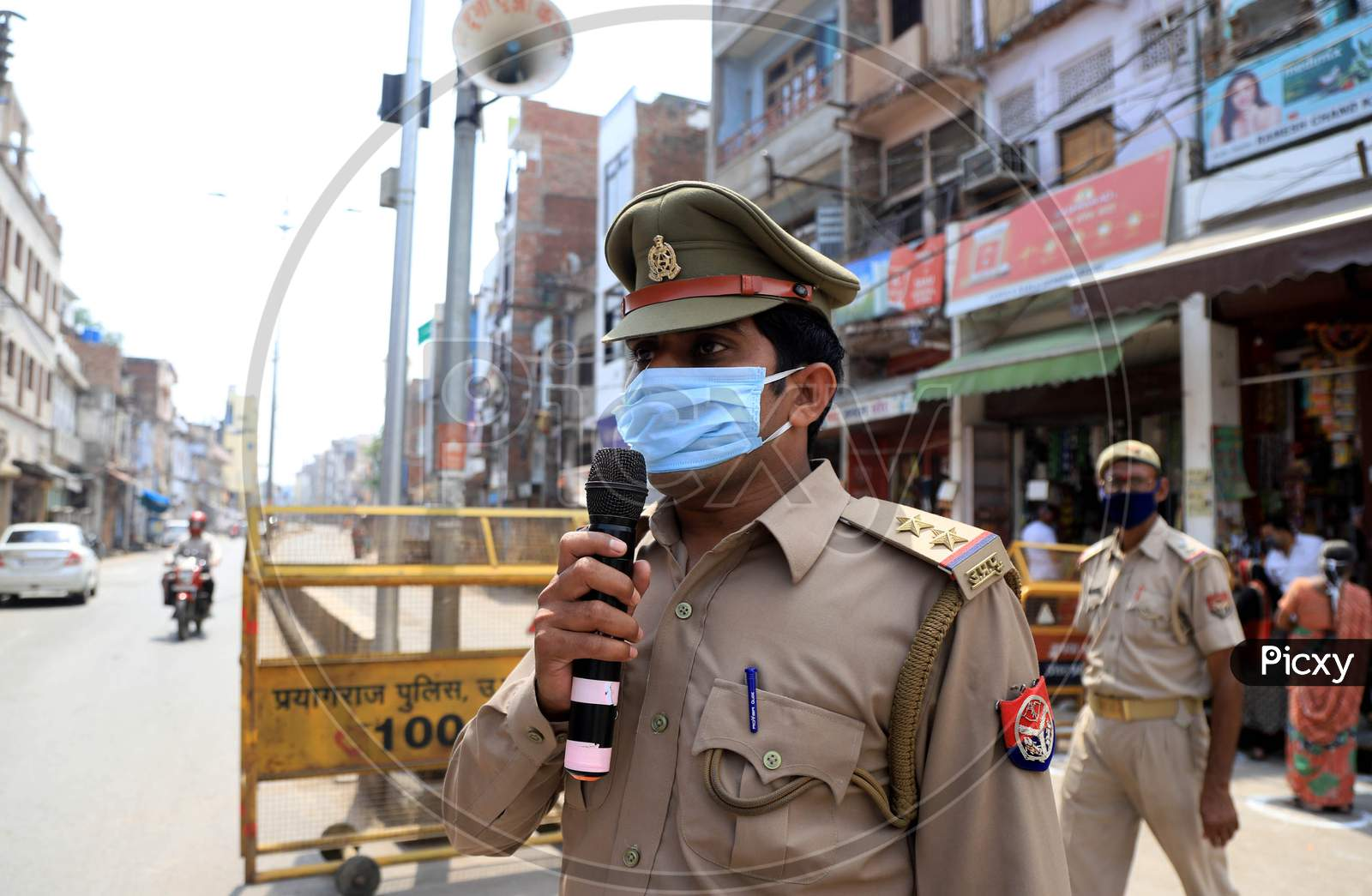 A Policeman Announcing To  Stay In Homes At  a Hot Spot Area  During Nationwide Lockdown Amidst  Coronavirus or COVID-19 Outbreak In Prayagraj, April 25 2020