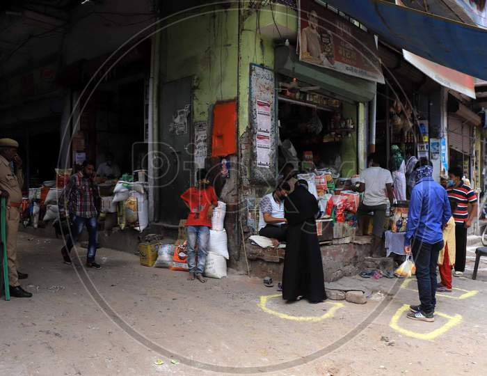 People Buying groceries At a Store during Nationwide Lockdown Amidst Coronavirus or COVID-19 Outbreak In Prayagraj