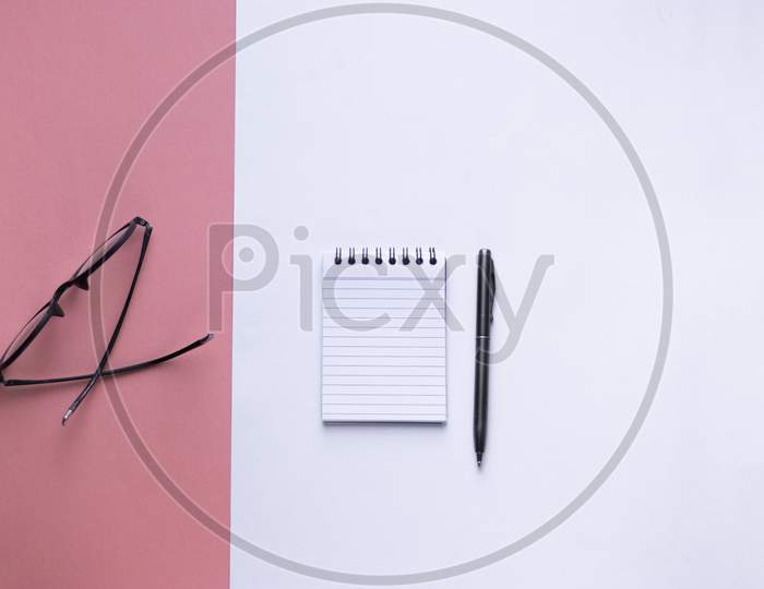 Flat Lay With Notes, Pen and Spectacles On an Isolated Background