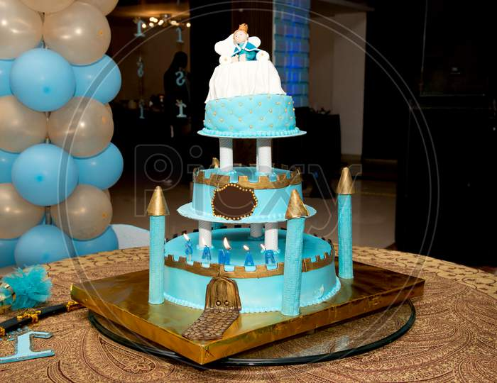 blue castle birthday cake with doll for kids party