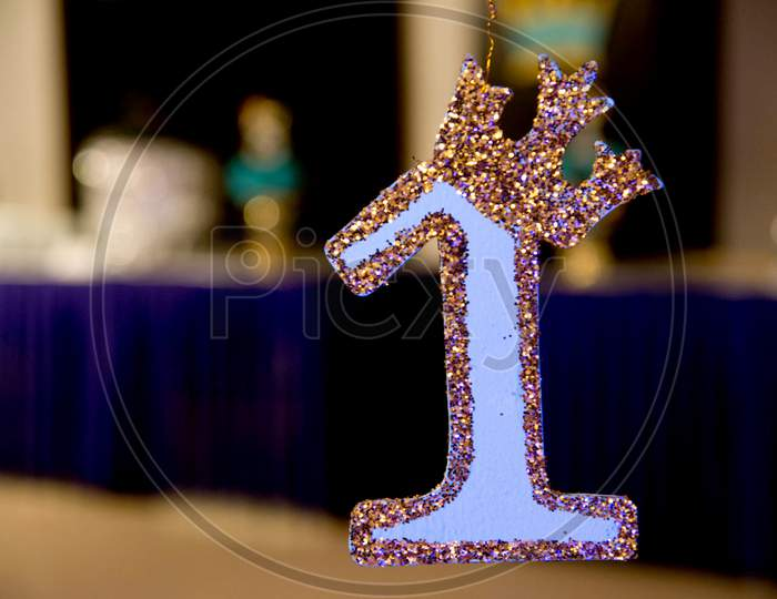 First Anniversary celebration. Golden number 1, sign for Birthday or wedding party event decoration.