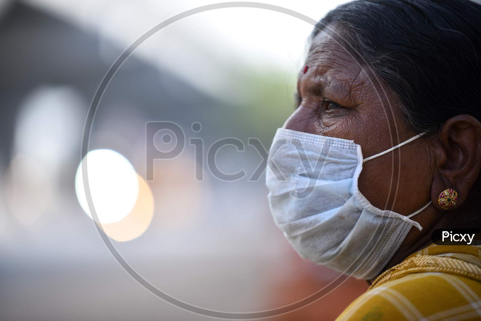 Roadside Woman Vendor Wearing Mask Safety From Corona Virus Or Covid 19 Virus Spread