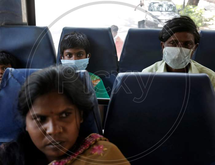 Migrant workers and their children sit in a bus before being repatriated to their villages by the government during a nationwide lockdown to prevent the spread of coronavirus (COVID-19) in Bangalore, India, April 30, 2020.