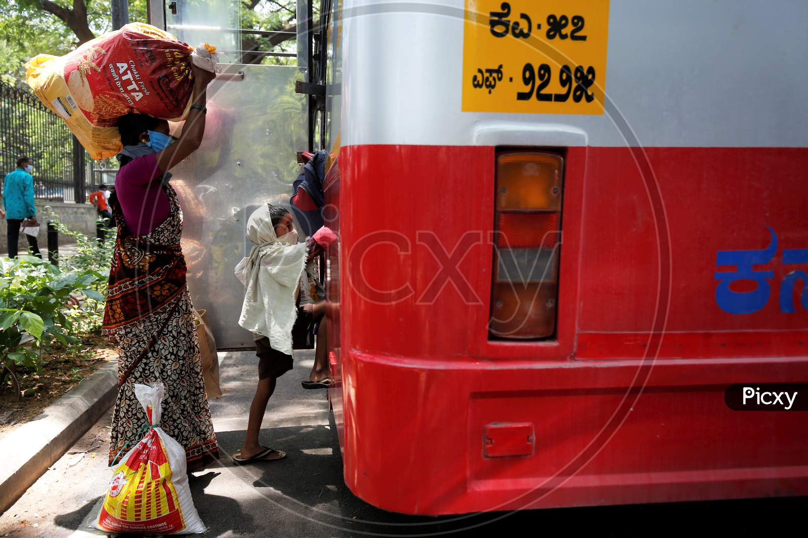 The child of migrant workers climbs into a bus prior to being repatriated to his village by the government during a nationwide lockdown to prevent the spread of coronavirus (COVID-19) in Bangalore, India, April 30, 2020.