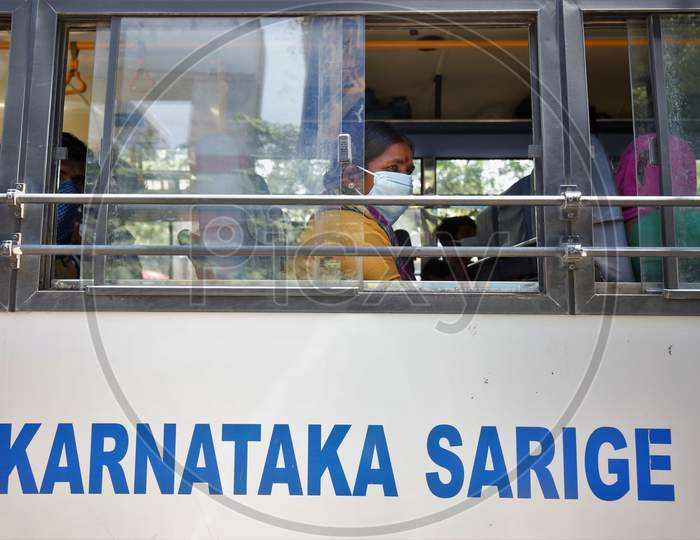 A migrant worker looks out of a bus window prior to being repatriated to her village by the government during a nationwide lockdown to prevent the spread of coronavirus (COVID-19) in Bangalore, India, April 30, 2020.